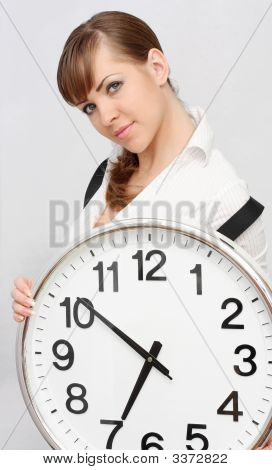 Young Beautiful Brunette Woman With Big Clock