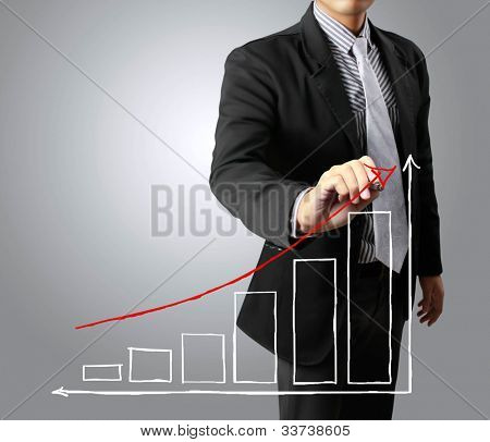 Business men hand drawing a graph growth