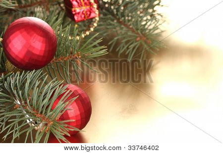 Christmas tree with beautiful New Year's balls on table