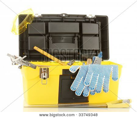 Open yellow tool box with tools isolated on white background