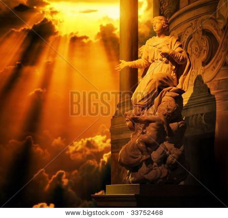 Classical marble statue of a woman with hand out stretched and cherubs at her feet bath in golden light from above