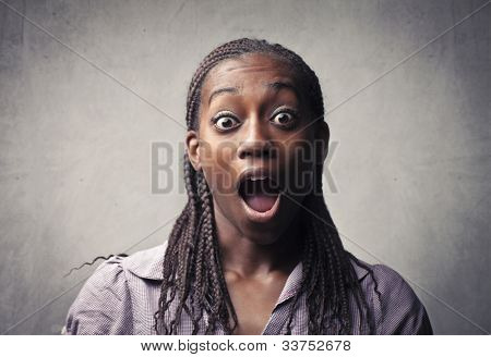 Astonished african young woman