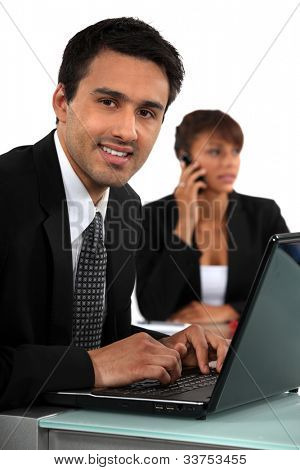 Smiling businessman with a laptop