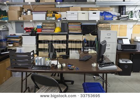 Untidy shop space office with boxes, files and clutter