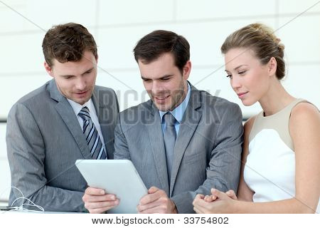 Business team working with electronic tablet
