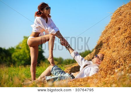 Sexy passion between lovers on hayloft