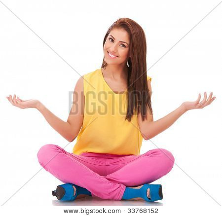 picture of a young healthy woman sitting and welcoming to relax over white background