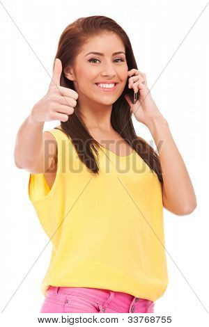 casual woman on the phone with her thumbs up , isolated on white background