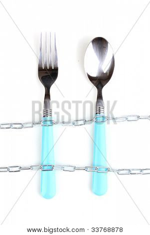 Fork and spoon with chain isolated on white