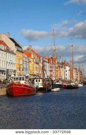 COPENHAGEN, DENMARK - AUGUST 25: unidentified people in open cafees of the Nyhavn promenade on August 25, 2010 in Copenhagen, Denmark. Nyhavn district is one of the most famous landmark of Copenhagen.