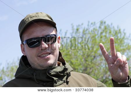 Man Showing Victory Fingers Sign