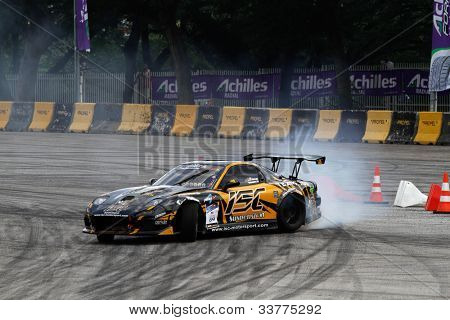 KUALA LUMPUR - MAY 19: Malaysia's Mervyn Nakamura driving a Nissan RX-7 makes a practice run during the Formula Drift 2012 Asia Round 1 on May 19, 2012 in Speedcity, Kuala Lumpur, Malaysia.