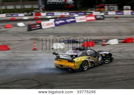 KUALA LUMPUR - MAY 19: Thailand's Nattawoot driving a Nissan RX-7 makes a practice run during the Formula Drift 2012 Asia Round 1 on May 19, 2012 in Speedcity, Kuala Lumpur, Malaysia.
