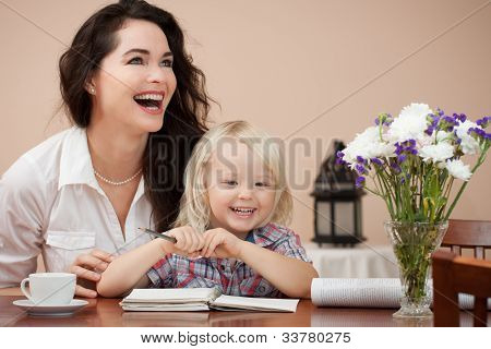 Happy Mother And Son At Table