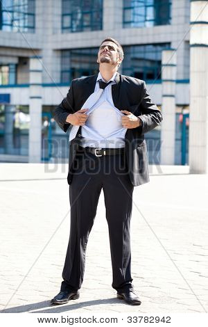 Superhero businessman ripping off his blue shirt, businessman in action