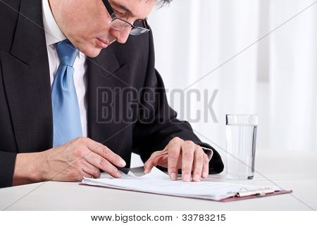 Senior businessman concentrate reading and  checking contract