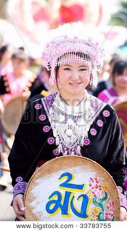 CHIANG MAI, THAILAND - FEBRUARY 4: Traditionally dressed Mhong hill tribe woman in procession on Chiang Mai 36th Flower Festival on February 4, 2012 in Chiang Mai, Thailand