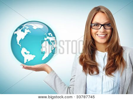 Happy businesswoman holds earth model on her palm