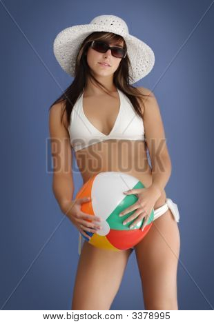 Young Woman In Bikini With Ball