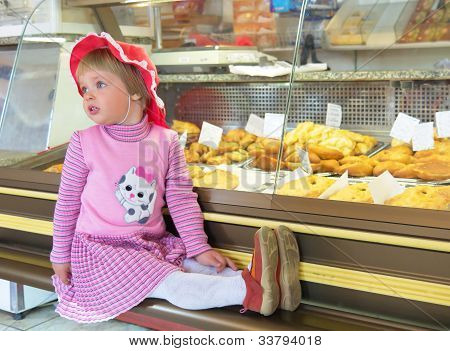 Little Girl Sitting In The Shop