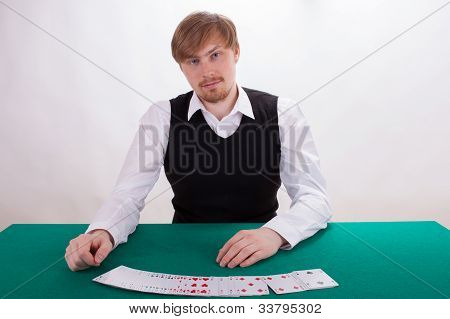 A Young Man Is Playing Poker