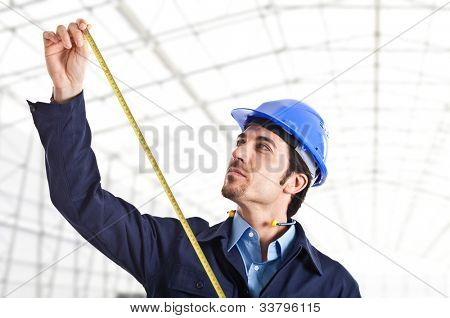 Portrait of a worker using a tape measure