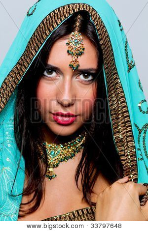portrait of a beautiful woman in a turquoise sari