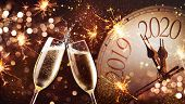 New Years Eve celebration background. Toast with fireworks and champagne at midnight poster