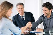 foto of recruiting  - Handshake to seal a deal after a job recruitment meeting - JPG