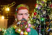Merry Christmas And Happy New Year. Bearded Man With Decorated Beard. Christmas Decorations. Decorat poster