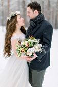 Winter Wedding, Stylish Young Couple, Bride And Groom, In The Forest, Tender Hugs. Bride With Long H poster