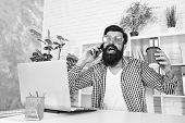Cup Of Coffee Is Really About Communication. Bearded Man Communicating By Smartphone. Hipster Workin poster