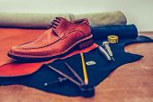 Man Classic Brown Shoes And Leather Shoemaking Tools And Set Of Leather Craft Tools poster