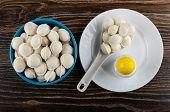 Raw Frozen Small Dumplings In Blue Bowl, Plastic Spoon With Dumplings, Salt Shaker In White Plate On poster