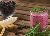 Blackcurrant Smoothie With Banana And Mint In A Glass Cup. Smoothie Is Decorated With Mint Leaves, A poster