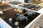 Hybrid gas and electric induction stove with black glass tray selling in appliance retail store show poster