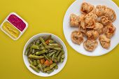 Dumplings On A White Plate Against A Yellow Background. Dumplings Meat In Tomato Sauce With Vegetabl poster