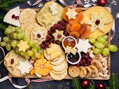 Christmas Cheese Board Appetizers Platter With Various Types Of Cheese, Crackers, Jam, Fruits And Pi poster