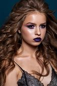 Young Beautiful Model With A Professional Violet Smoky Eyes, Volume Wavy Hairstyle And Dark Lips. poster