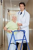 picture of zimmer frame  - Young happy doctor helping a senior woman with her walker - JPG