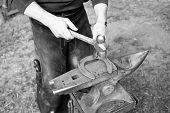 Blacksmith Forges Horseshoe With Hammer On Anvil. Ancient Craft. Village Craft. Blacksmith Working M poster