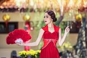 Beauty Woman Wear Cheongsam  In Chinese New Year. poster
