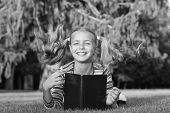 Adorable Bookworm. Schoolgirl Reading Stories Relaxing Green Lawn. Cute Pupil Enjoy Reading. School  poster