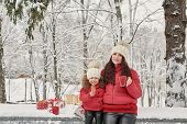 Happy Family Mother And Child Daughter On Winter Walk Outdoors Drinking Tea. Happy Family Mother And poster