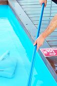 Hand Of Caucasian Pool Cleaner During His Work. Cleaning Robot For Cleaning The Botton Of Swimming P poster