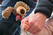 Hands Of Parent And Child Outdoor Closeup. Father Holds Hands Of Little Girl. Childs And Male Hands  poster