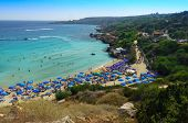People at the famous beach of Konnos Bay Beach, Ayia Napa. Famagusta District, Cyprus. Best beaches  poster