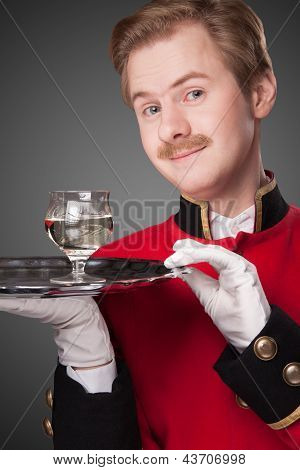 Smiling Waiter in red uniform