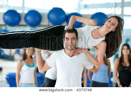 Gym Man Lifting A Woman