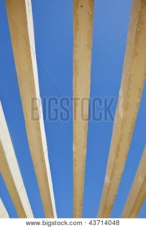 Vertical Concrete Shapes On A Rich Blue Sky